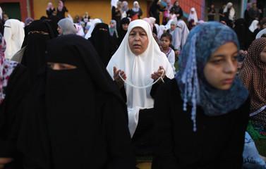 Palestinian women attend Eid al-Fitr prayers in Gaza City