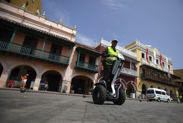 A Colombian police officer patrols inside the old city in Cartagena