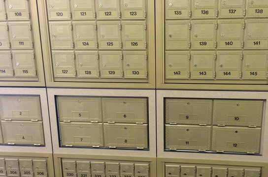 Banks of Mail Boxes Etc.Õs signature golden mail boxes are seen at a branch in London