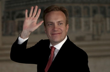 Brende waves as he arrives to meet Abbas in the West Bank city of Ramallah