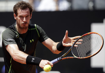 Murray of Britain returns to Chardy of France during their second round match at Rome Open tennis tournament