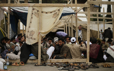 Followers of the Shi'ite Houthi movement sit at an anti-government protest camp in Sanaa