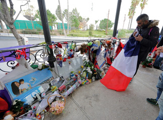 Nice town hall employees collect in boxes the flowers, drawings and toys left by passers-by at a memorial for the victims of the July 14 fatal truck attack on the Promenade des Anglais in Nice