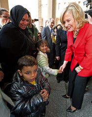 U.S. Secretary of State Clinton greets the family members of Khairy Ramadan Ali, who was killed in anti-government protests, during her visit to Cairo