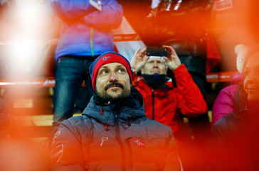 Norway's Crown Prince Haakon watches the men's large hill team ski jumping final at the Nordic World Ski Championships in Falun