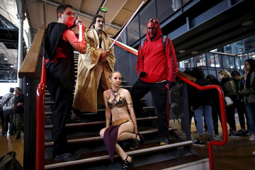 Paris Comic Con attendees pose during the first day of the event in Paris