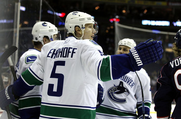 Vancouver Canucks' Christian Ehrhoff celebrates after scoring a goal against the Columbus Blue Jackets during the first period of their NHL hockey game in Columbus