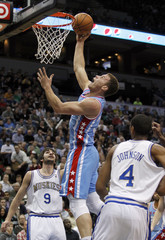 Los Angeles Clippers forward Griffin shoots over Minnesota Timberwolves guard Rubio in Minneapolis