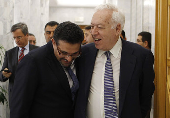 Spain's Foreign Affairs Minister Jose Manuel Garcia Margallo speaks with his Tunisian counterpart Rafik Abdessalem in Tunis