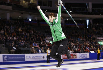 Saskatchewan skip Shumay celebrates defeating Newfoundland and Labrador during the sixteenth draw at the Scotties Tournament of Hearts curling championship in Kingston