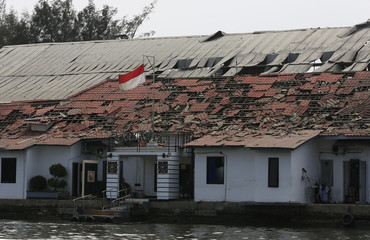An Indonesian flag is seen at a Navy ammunition warehouse, after an explosion took place in Pondok Dayung island, Jakarta