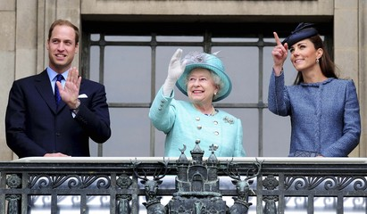 Britain's Queen Elizabeth, Prince William, and the Duchess of Cambridge wave from the balcony during a visit  to the Council House, in Nottingham