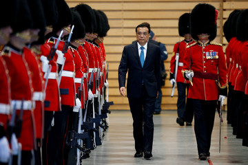 Chinese Premier Li Keqiang inspects the honour guard during a welcoming ceremony in Ottawa