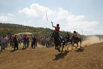 Palestinian jockeys  take part in a horse race in Abu Falah village, near the West Bank city of Ramallah