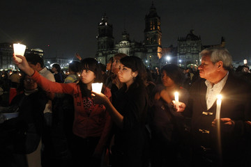 "Members of the movement ""Yosoy132"" hold candles during a demonstration to demand transparency in the next election at Zocalo square in Mexico city"