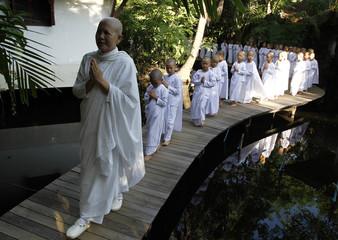 A Buddhist nun walks in line with novice Thai nuns at the Sathira Dammasathan Buddhist meditation centre in Bangkok