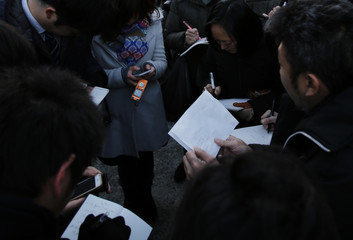 Journalists share comments given by Junko Ishido, mother of Kenji Goto, in front of her house in Tokyo