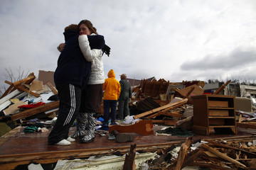 Betty Fannin hugs her granddaughter Jade Fannin in front of Jade's home, which was destroyed by a tornado in West Liberty