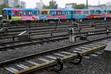 A Kiev metro train painted by Spanish artist Kenor is seen in a depot in Kiev