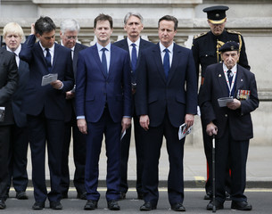 Former Labour Party leader Miliband former Liberal Democrat leader Clegg and Britain's Prime Minister Cameron attend VE day ceremony in London