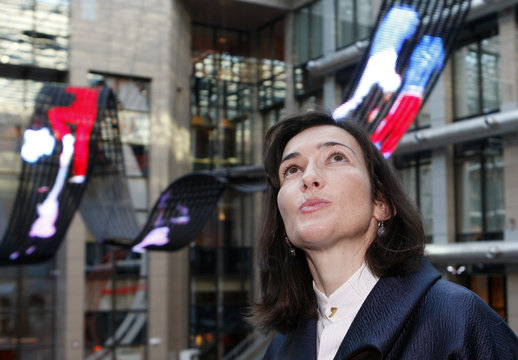 Spain's Culture Minister Gonzalez-Sinde is seen with a LED screen art installation by Spanish artist Canogar in the background, at the European Council building in Brussels