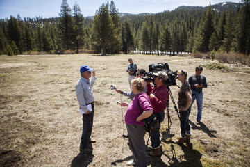 Frank Gehrke, chief of snow surveys for the California Department of Water Resources, speaks to reporters after measuring the snowpack in Phillips, California