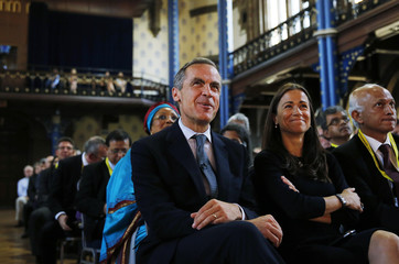 Bank of England Carney listens as he is introduced before speaking at the Commonwealth Games Business Conference in Glasgow, Scotland