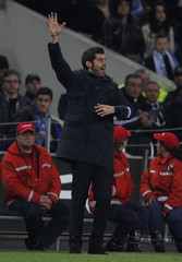 Porto's coach Fonseca gives instructions to his players during their Portuguese premier league soccer match against Estoril in Porto