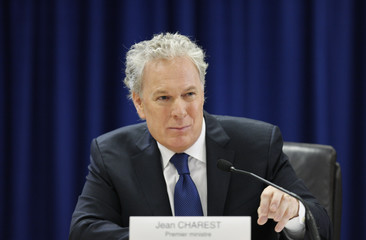 Quebec's Premier Jean Charest speaks as he testifies during the Inquiry Commission into the appointment process for judges in Quebec City