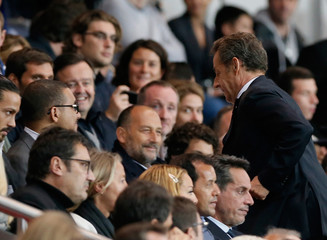 Former French president Nicolas Sarkozy arrives to attend the French Ligue 1 soccer match between Paris St Germain and Olympique Lyon at the Parc des Princes Stadium in Paris