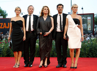 "Director Ozon and actors Viard, Luchini, Deneuve and Godreche pose during the ""Potiche"" red carpet event at the 67th Venice Film Festival"