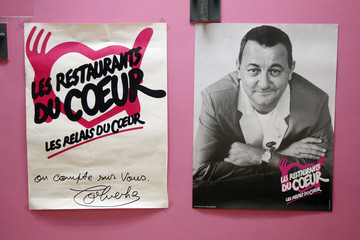 "A picture of late French comic Coluche is pictured at a food distribution centre for the ""Les Restos du Coeur"" (Restaurants of the Heart) in Paris"