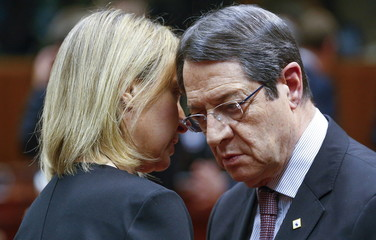 EU foreign policy chief Mogherini and Cyprus President Anastasiades attend a European Union leaders summit over migration, in Brussels