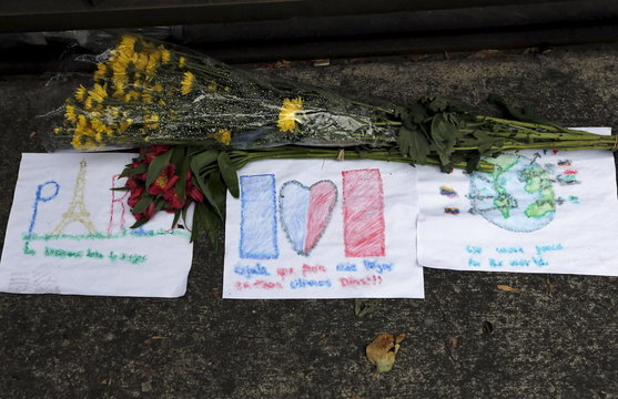 Flowers, drawings and messages are left in remembrance of the victims of the Paris attacks, at the French Embassy in Bogota, Colombia