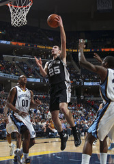 San Antonio Spurs' De Colo shoots against Memphis Grizzlies' Arthur and Davis during their NBA basketball game in Memphis