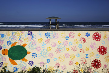 A lifeguard's watchtower and drawings on an anti-tsunami wall are seen on the Usuiso beach that is closed for public in tsunami destroyed coastal area near Iwaki town, south of the crippled Fukushima Daiichi nuclear power plant in Fukushima prefecture
