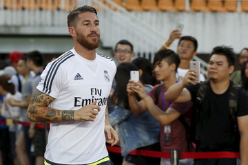 Real Madrid's Sergio Ramos attends a training session at Tianhe Stadium in the southern Chinese city of Guangzhou, China