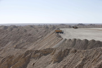 A vehicle carries untreated phosphate after being dropped off on a mountain at a phosphate mine at Boucraa factory of the National Moroccan phosphate company (OCP) situated in the southern provinces