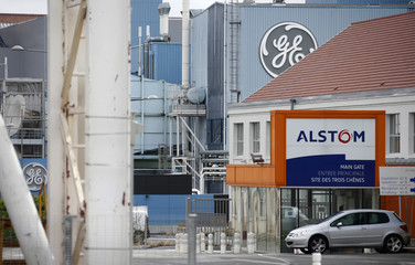The logos of French power and transport engineering company Alstom and US conglomerate General Electric are pictured at the site of the companies in Belfort