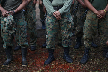 The wedding ring of Cecilia Chavez is seen as she stands in formation during the International Anti-Narcoterrorism Combat course at a temporary police camp in the Darien area near the Panama-Colombia border