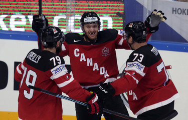 Canada's Couturier celebrates his goal against the Czech Republic with team mates during their Ice Hockey World Championship game at the O2 arena in Prague