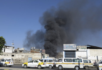 Smoke rises from a fire at a market in Sanaa