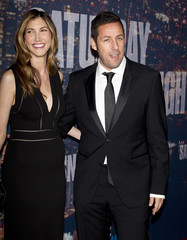 Actor Adam Sandler and wife Jackie Sandler arrive for the 40th Anniversary Saturday Night Live (SNL) broadcast in the Manhattan Borough of New York
