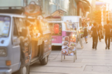 Abstract blurred background food trucks carnival.
