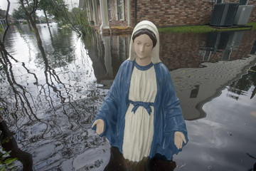 Statue of Virgin Mary stands in yard of house flooded by Hurricane Isaac in La Place