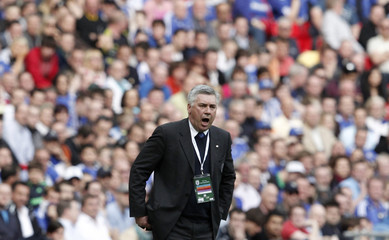 Chelsea's manager Carlo Ancelotti reacts during their FA Cup semi-final soccer match against Aston Villa in London