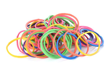 Colorful rubber bands on white background
