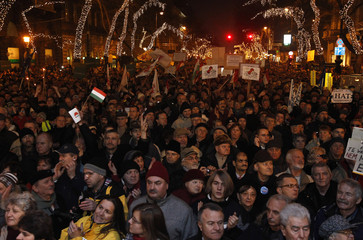 People attend a protest in central Budapest