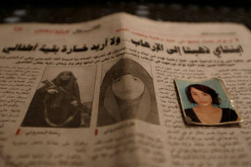 Photographs of Rahma, the wife of Noureddine Chouchane, who was killed during a U.S air strike in Libya, and her sister Ghofran, are seen in a newspaper in Tunis
