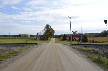 Unimproved road and an uncontrolled railroad crossing in the rural countryside